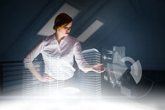 Composite image of redhead businesswoman using interactive desk Royalty Free Stock Image
