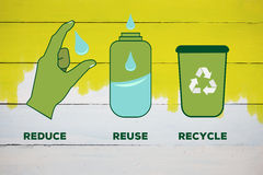 Composite image of reduce reuse recycle. Reduce reuse recycle against yellow paint on fence Royalty Free Stock Photography