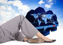 Composite image of relaxed businesswoman lying Stock Images