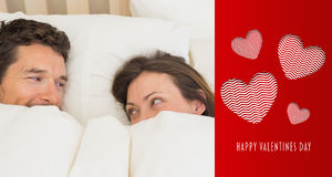 Composite image of relaxed couple lying together in bed Stock Photo