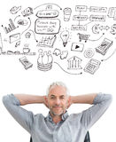 Composite image of relaxed mature businessman with hands behind head Royalty Free Stock Photos