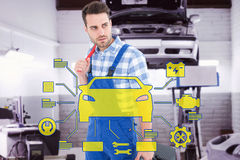 Composite image of repairman carrying toolbox while looking asway Royalty Free Stock Image