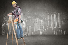 Composite image of repairman climbing ladder while holding power drill. Repairman climbing ladder while holding power drill against hand drawn city plan Stock Photography