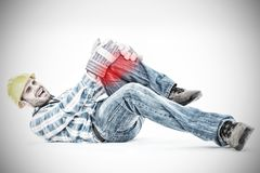 Composite image of repairman suffering from knee pain. Repairman suffering from knee pain against highlighted pain Royalty Free Stock Images