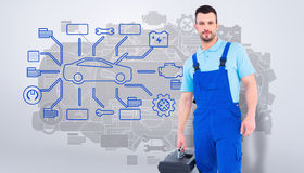 Composite image of repairman with toolbox Stock Photo