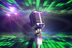 Composite image of retro chrome microphone Stock Photo