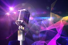 Composite image of retro chrome microphone Royalty Free Stock Photos
