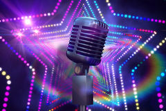 Composite image of retro chrome microphone Royalty Free Stock Images