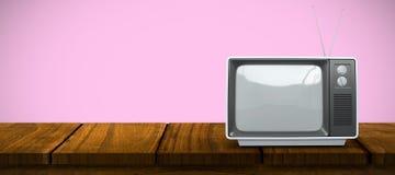 Composite image of retro tv. Retro tv against pink background Stock Photo