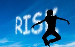 Composite image of risk written in white in sky Stock Photo