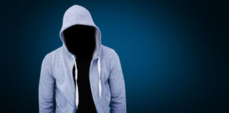 Composite image of robber wearing gray hoodie. Robber wearing gray hoodie against blue background with vignette Royalty Free Stock Photo
