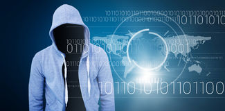 Composite image of robber wearing gray hoodie. Robber wearing gray hoodie against blue background with vignette Stock Image