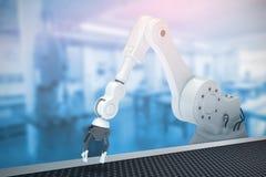 Composite image of robotic arm 3d. Robotic arm against workshop 3d Royalty Free Stock Image