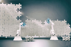 Composite image of robotic arms setting up blue jigsaw piece on puzzle 3d Royalty Free Stock Images