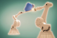 Composite image of robotic hands holding blue cloud against green background Stock Image