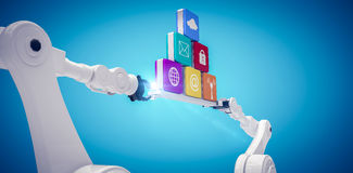 Composite image of robotic hands holding computer icons against blue vignette. Robotic hands holding computer icons against white background against blue Stock Image