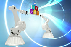 Composite image of robotic hands holding computer icons over blue background. Robotic hands holding computer icons over white background against blue spiral with Stock Photo