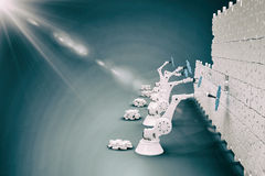 Composite image of robotic machineries setting up blue jigsaw piece on puzzle 3d. Robotic machineries setting up blue jigsaw piece on puzzle against blue Royalty Free Stock Photos