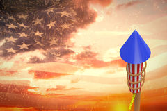 Composite image of rocket for firework. Rocket for firework against digitally generated american flag waving Stock Images