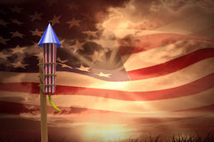 Composite image of rocket for fireworks. Rocket for fireworks against composite image of digitally generated american flag rippling Royalty Free Stock Image