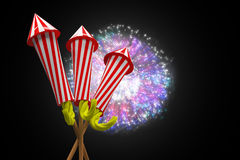 Composite image of rockets for fireworks. Rockets for fireworks against colourful fireworks exploding on black background Royalty Free Stock Photos