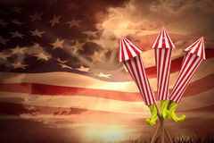 Composite image of rockets for fireworks. Rockets for fireworks against composite image of digitally generated american flag rippling Stock Photography