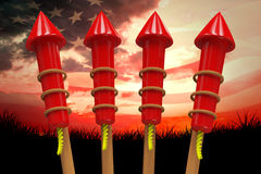 Composite image of rockets for fireworks. Rockets for fireworks against composite image of digitally generated american flag rippling Royalty Free Stock Photos