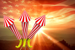 Composite image of rockets for fireworks. Rockets for fireworks against composite image of digitally generated american flag rippling Stock Photo