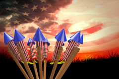 Composite image of rockets for fireworks. Rockets for fireworks against composite image of digitally generated american flag rippling Stock Photos