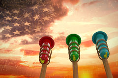 Composite image of rockets for fireworks. Rockets for fireworks against digitally generated american flag waving Stock Photo