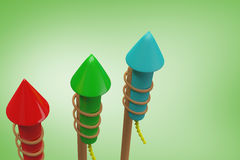 Composite image of rockets for fireworks. Rockets for fireworks against green vignette Royalty Free Stock Photo
