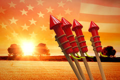Composite image of rockets for fireworks. Rockets for fireworks against panoramic view of american flag Royalty Free Stock Photography