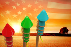 Composite image of rockets for fireworks. Rockets for fireworks against panoramic view of american flag Royalty Free Stock Photo