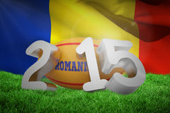 Composite image of romania rugby 2015 message. Romania rugby 2015 message  against waving flag of romania Stock Photos