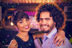 Composite image of romantic couple dancing together on dance floor Royalty Free Stock Images
