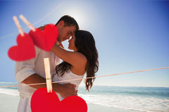 Composite image of romantic couple embracing Royalty Free Stock Images