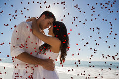 Composite image of romantic couple embracing Stock Photos