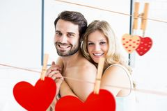 Composite image of romantic couple embracing Stock Photo