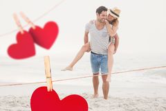 Composite image of romantic couple enjoying on the beach Royalty Free Stock Image