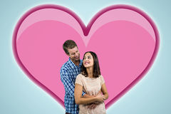 Composite image of romantic couple hugging Royalty Free Stock Photography