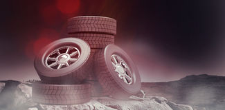 Composite image of row of tyres 3d. Row of tyres against mountain trail 3d Stock Image