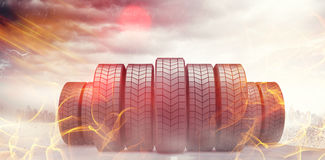 Composite image of row of tyres 3d. Row of tyres against open road 3d Stock Image