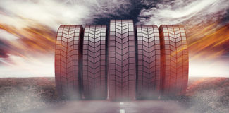Composite image of row of tyres 3d. Row of tyres against view of an empty street 3d Stock Photo
