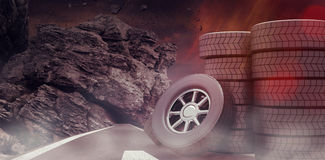 Composite image of rows of tyres 3d. Rows of tyres against dark road landscape 3d Royalty Free Stock Images