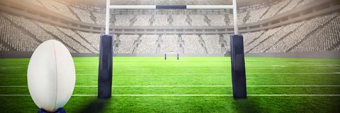 Composite image of rugby ball. Rugby ball against rugby stadium royalty free stock images