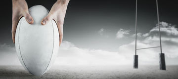 Composite image of rugby player catching a rugby ball Stock Images