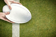 Composite image of rugby player catching a rugby ball Royalty Free Stock Photo