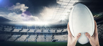 Composite image of rugby player catching a rugby ball Royalty Free Stock Photos