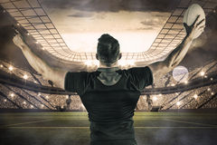 Composite image of rugby player celebrating with the ball Royalty Free Stock Images