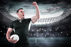 Composite image of rugby player cheering with the ball Stock Image